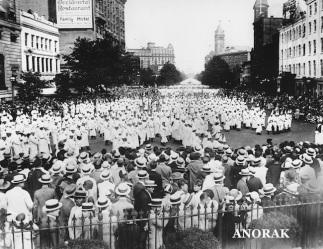 Ku Klux Klan members parade past the U.S. Treasury building in Washington, D.C. in 1925. (AP Photo)